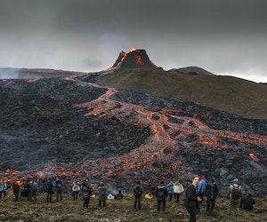 Crowds Flock to Iceland Volcano as Lava Spills