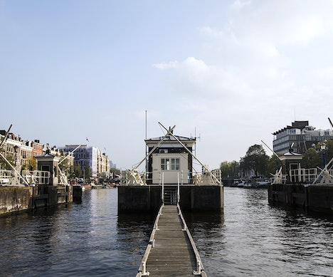 Amsterdam's Tiny Bridge Houses Are Now One-of-a-Kind Hotel Suites Amsterdam