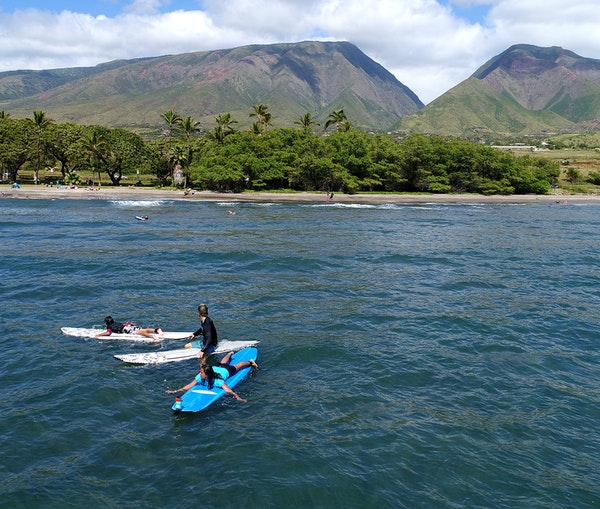 Learn to Ride the Waves in Maui at These Top 7 Surf Schools