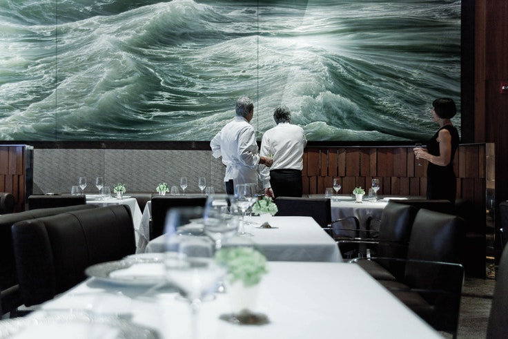 Alain Ducasse with chef Eric Ripert in the dining room ofRipert'sthree Michelin-starred Le Bernardin in Manhattan.