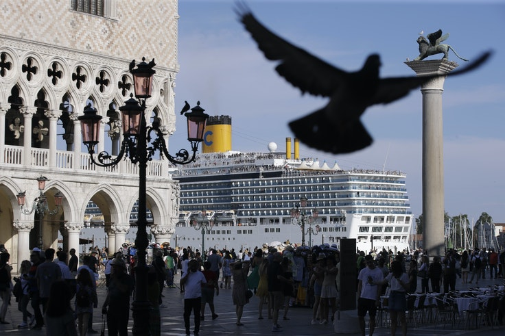 "A cruise ship passes by St. Mark's Square in Venice on the same day that the MSC ""Opera"" cruise ship crashed into another boat on the Giudecca Canal."