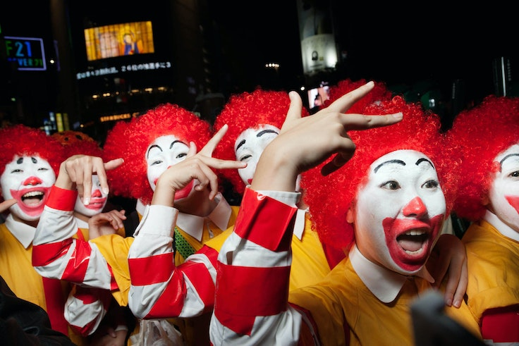 A swarm of Ronald McDonalds party on the streets of Shibuya in Tokyo, Japan.
