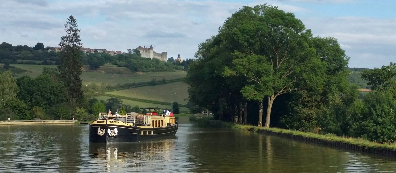 Barge cruises through the wine regions of France and other Europen countrysides give travelers a chance to savor life—and the destination—in the slow lane.