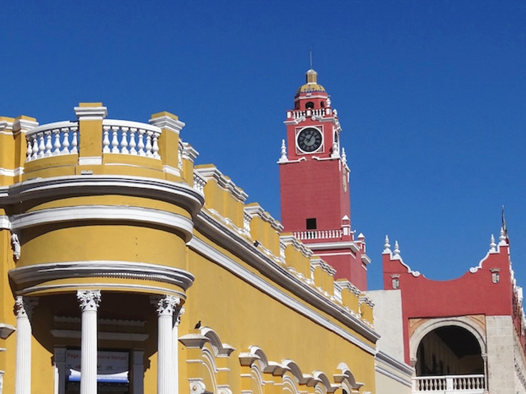 Thebright colors and colonial architecture of Merida are calling