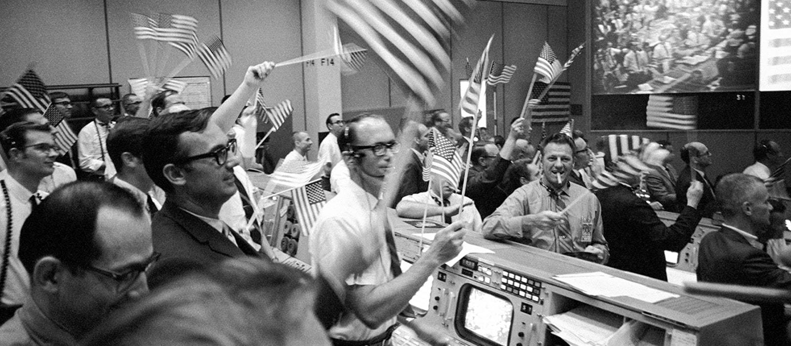 The Mission Operations Control Room, as it looked on July 24, 1969, as the flight controllers celebrated the return of the first lunar-landing mission.