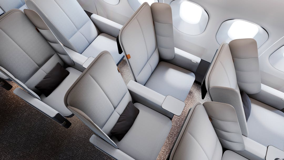 The design features two padded wings that can fold out from the seat back, allowing passengers to lean on a cushioned surface.
