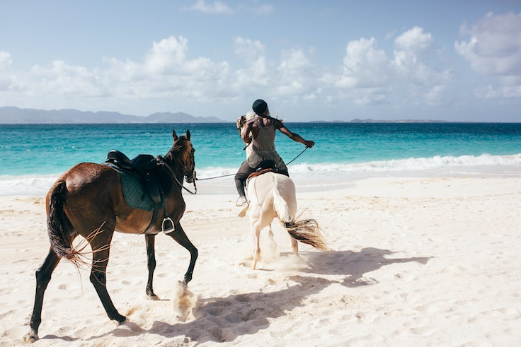 Go for a horseback ride on one of the Anguilla's beaches, which have been restored to their former glory, thanks in large part to volunteer clean-up efforts.