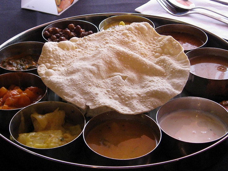 Thali is a delicious South Indian meal made up of a rainbow of dips and toppings
