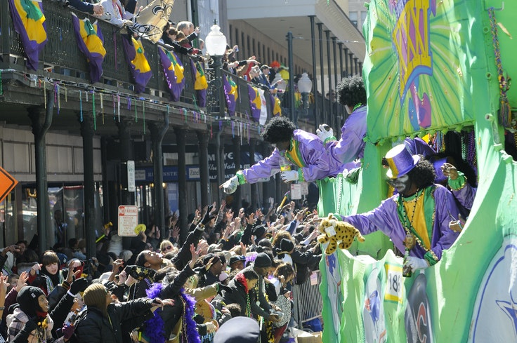 The 110-year-old Krewe of Zulu is best known for its coveted coconut throws, which are handed out to some of the luckier parade-goers.