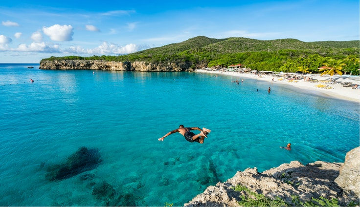 Swimming off of the Caribbean island ofCuraçao, which is known for its clear waters and coral reefs.