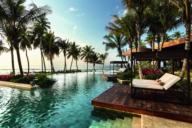 Hotels like the Ritz-Carlton Reserve Dorado Beach offer packages that replicate the experience of having elite status