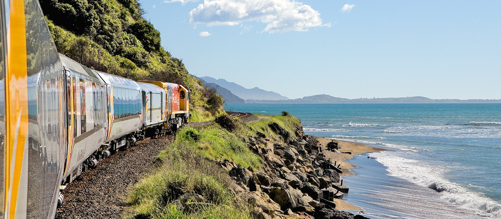 The soon-to-reopen Coastal Pacific Train heading north along the Pacific Coastline toward the coastal town of Kaikoura
