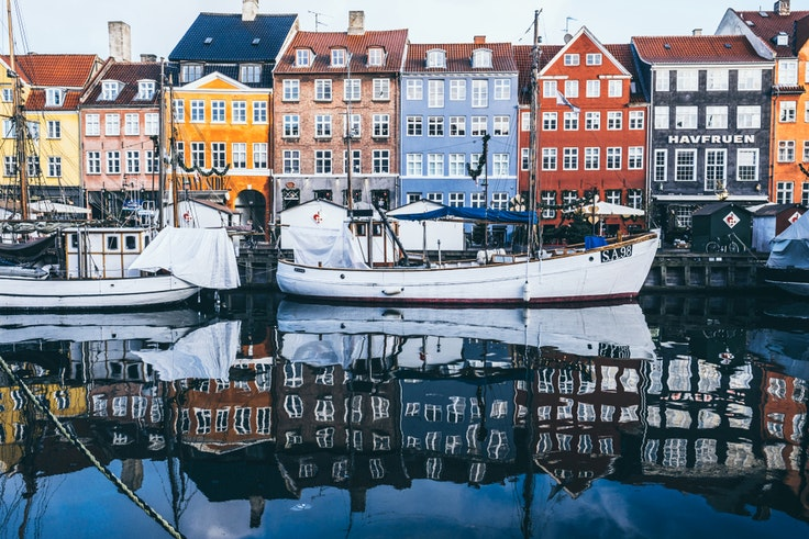 Colorful homes along the water on a December morning in Copenhagen.