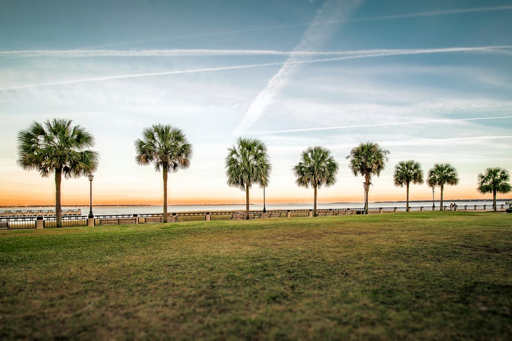 Watch the sunset in winter from Waterfront Park in Charleston, SC.