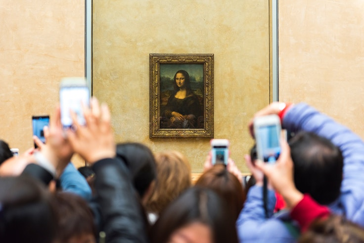 """Crowds around Leonardo da Vinci's """"Mona Lisa"""" have been a constant since the museum's opening."""