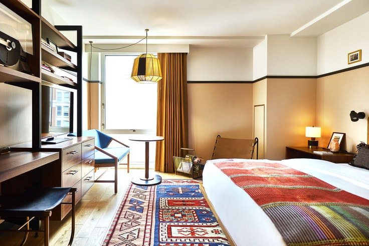 The guest rooms at Eaton DC were designed to impart a down-to-earth vibe with midcentury influences.