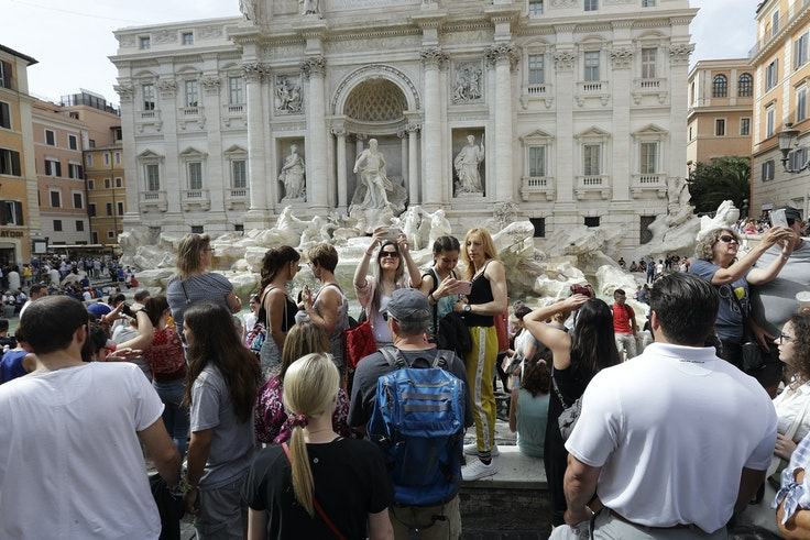 Rome's newall-encompassing law aims to prevent bad behavior by tourists that crowd popular landmarks like the Trevi Fountain.