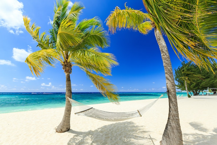 Picture yourself in this hammock on Grand Cayman's famed Seven Mile Beach.
