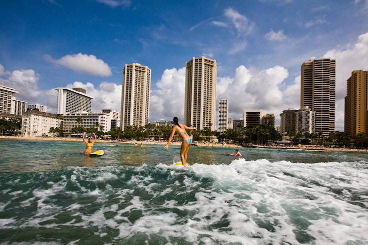 Hawaii's Waikiki Beach is legendary among surfers, and its Canoes break is one of the best spots in the nation to pick up new surfing skills.