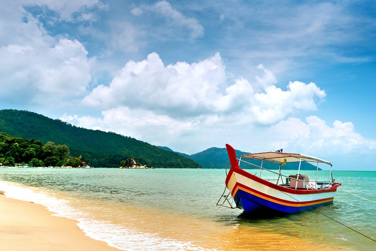 The tropical beaches are just another bonus to retired life on the island of Penang, Malaysia.