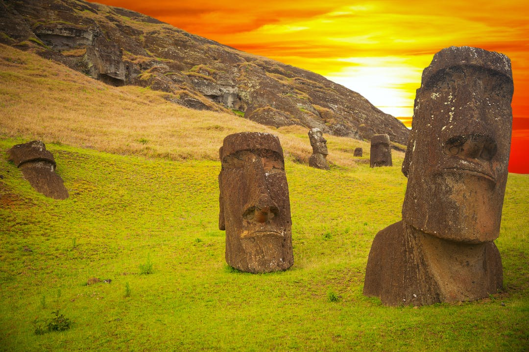 Moai, huge carved stone figures, dominate the landscape of Easter Island.