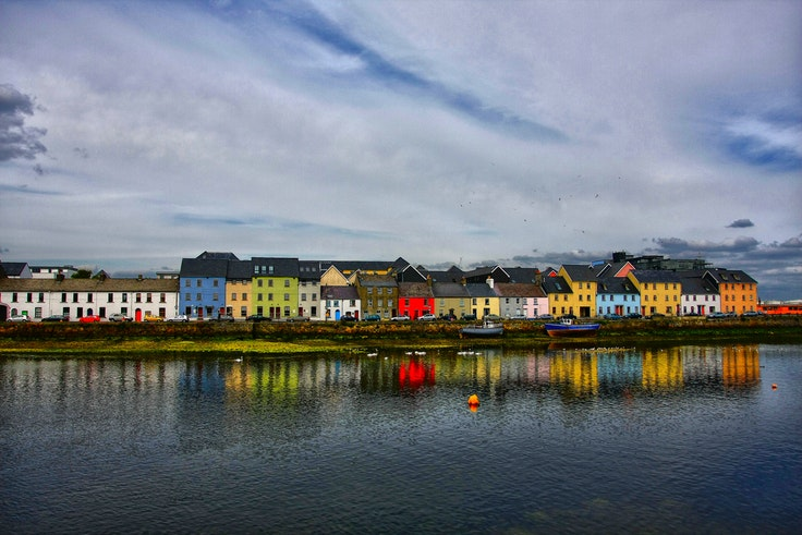 Colorful houses line the Long Walk in Galway, where the River Corrib meets Galway Bay.