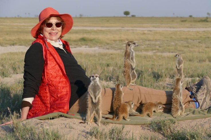 Katie Cadar befriends some meerkats in the Kalahari Desert in Botswana.