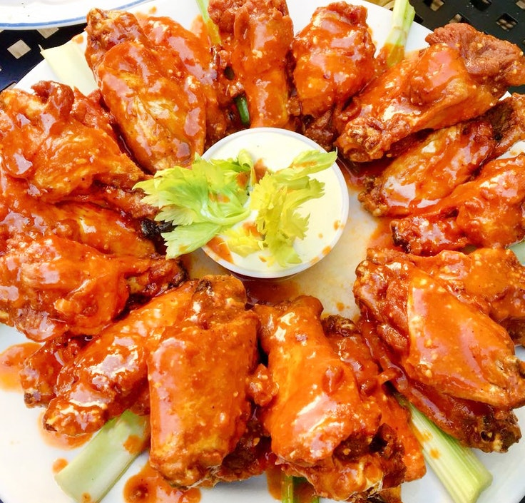The wings at The Nine-Eleven Tavern come smothered in house-made sauce.