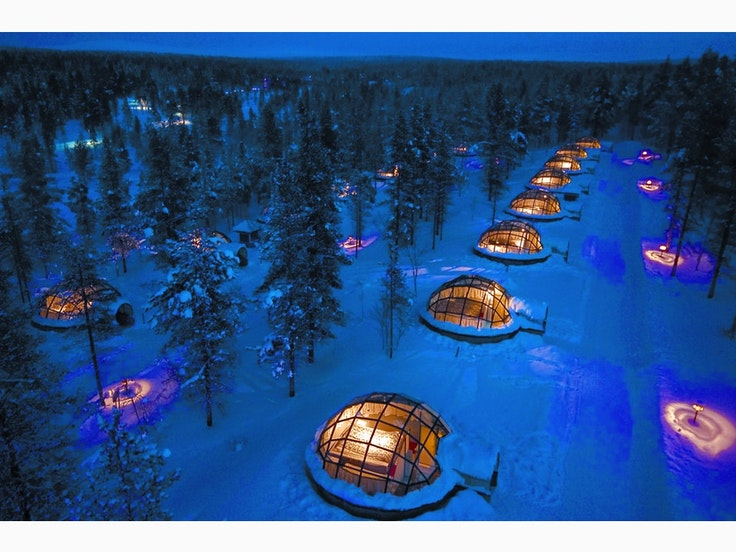 Watch the Northern Lights dance with your boo in a dreamy Finnish igloo.