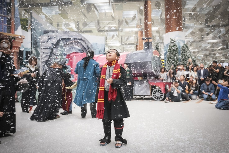Imitation snow falls over a recreation of Hogsmeade Village at Singapore's Changi Airport.