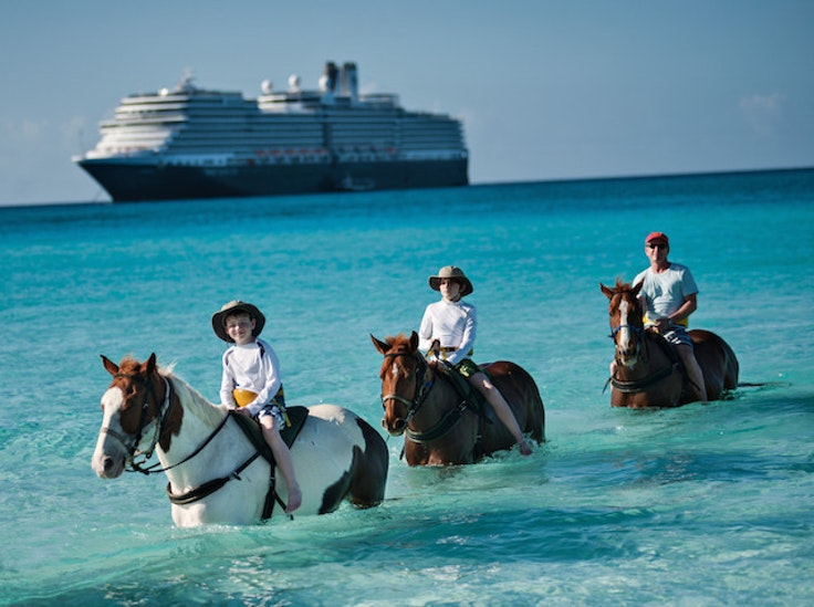 Cruisers get off the Holland America Line Eurodam and onto horseback at Half Moon Cay in the Bahamas.