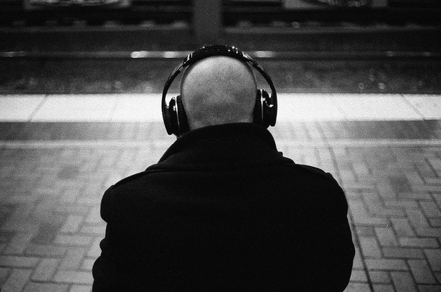 16 Best Podcasts to Keep You Occupied During Holiday Travel
