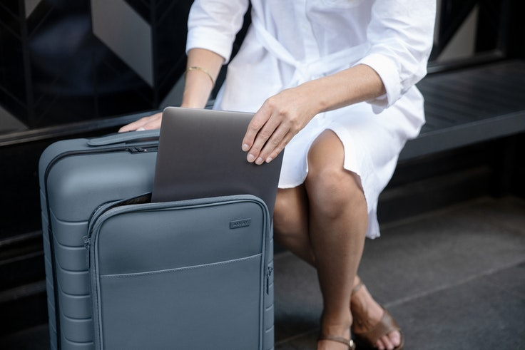The leather pocket on Away's new carry-on fits your laptop and so much more.