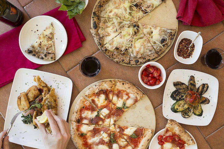 Tuck into unforgettable Naples-style pies at Uptown's Spacca Napoli.