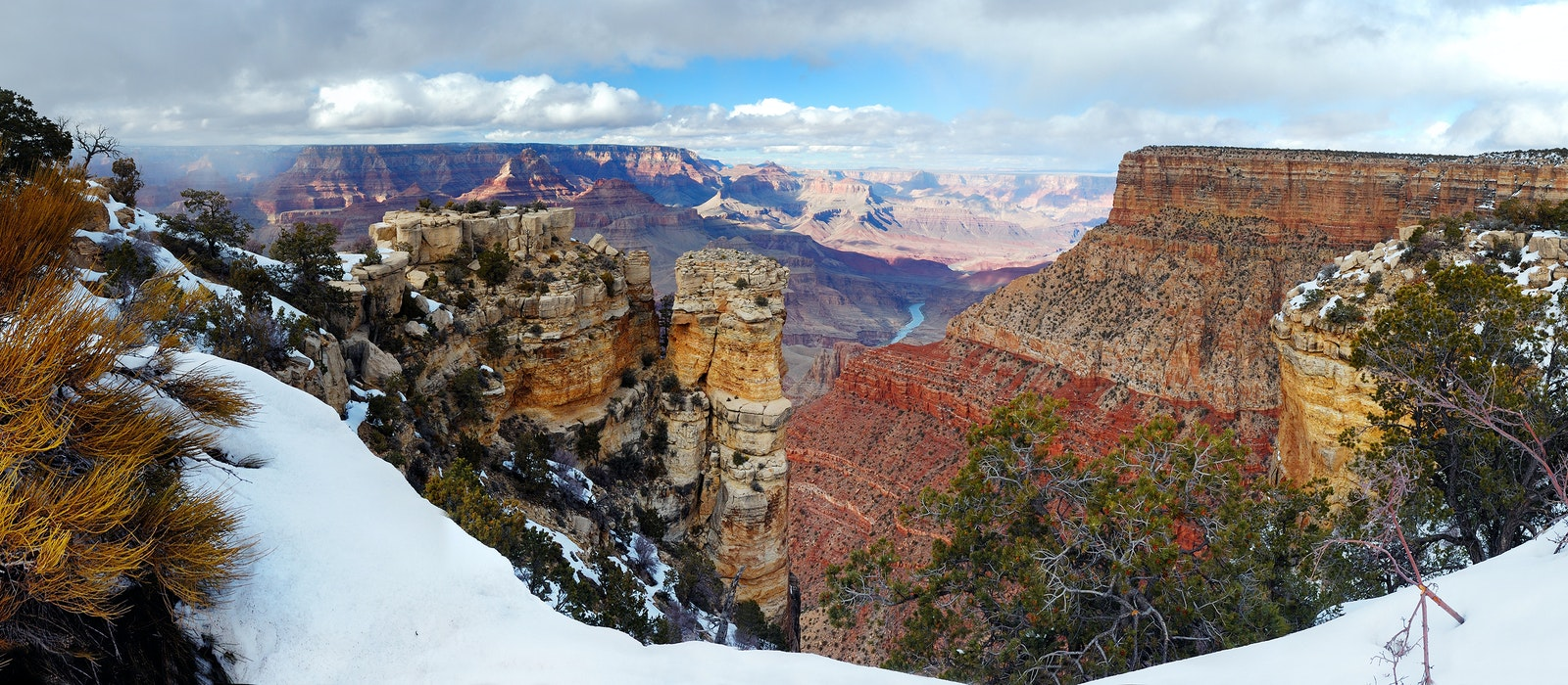 During winter, snow often dusts the red walls of Grand Canyon National Park.
