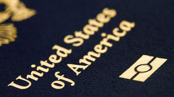 The circle-inside-two-bars symbol on your passport signifies the presence of an RFIDchip embedded in the cover.