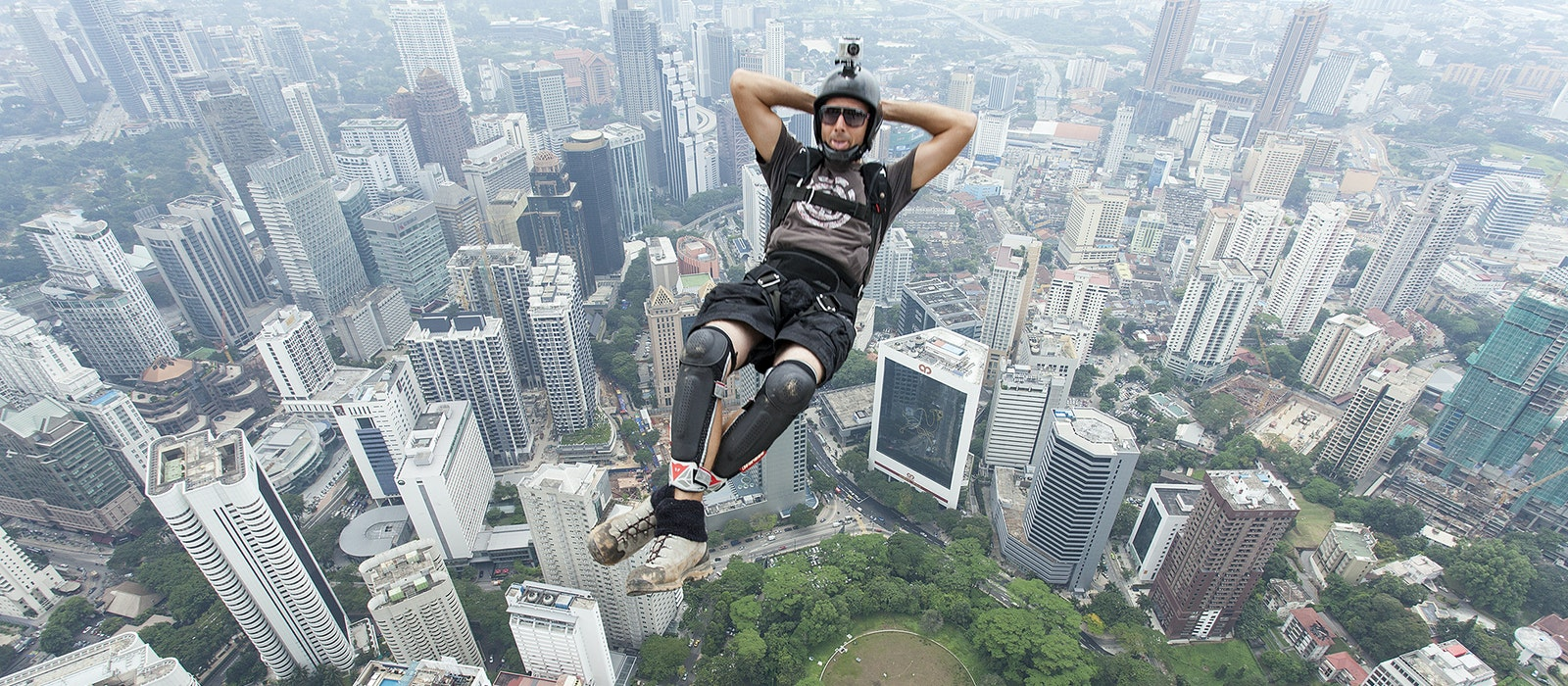 A BASE jumper exitsKuala Lumpur's 1,099-foot KL Tower during an annual event that attracts dozens of daredevils.