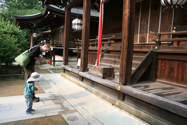 Jeremy and Luke Saum pay their respects at the Kitano Tenmangu shrine in Kyoto.