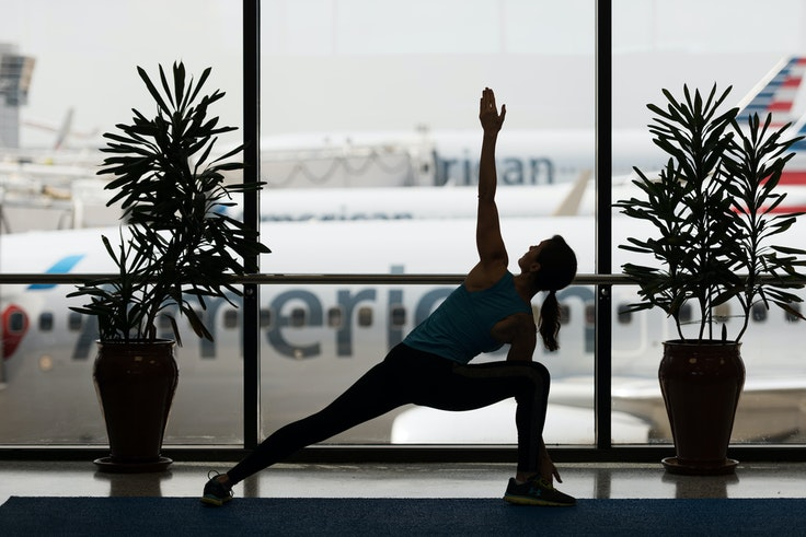 Work out your stress or your sore muscles at airport yoga spaces like DFW's Yoga Room.