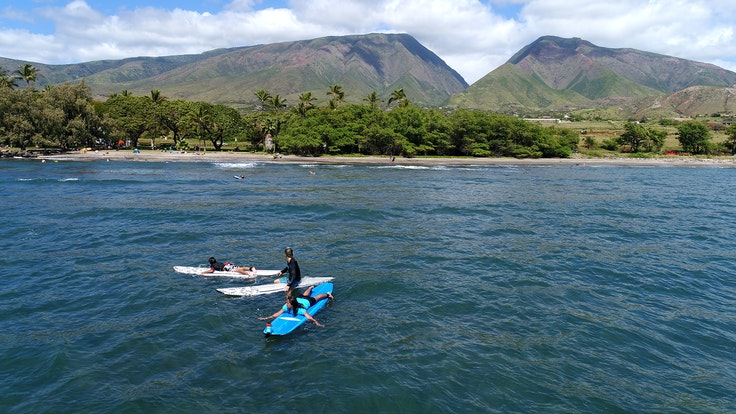 Hawaiian Paddle Sports offers surf instruction on Maui, with a company ethos that embraces sustainability.