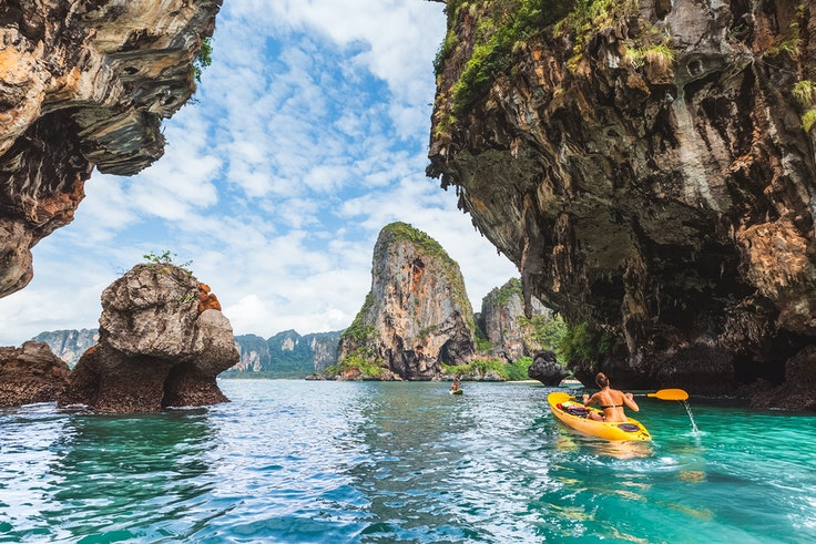 Phuket, Thailand's largest island, offers idyllic settings (like this one near Railay Beach) and an atmospheric Old Town.