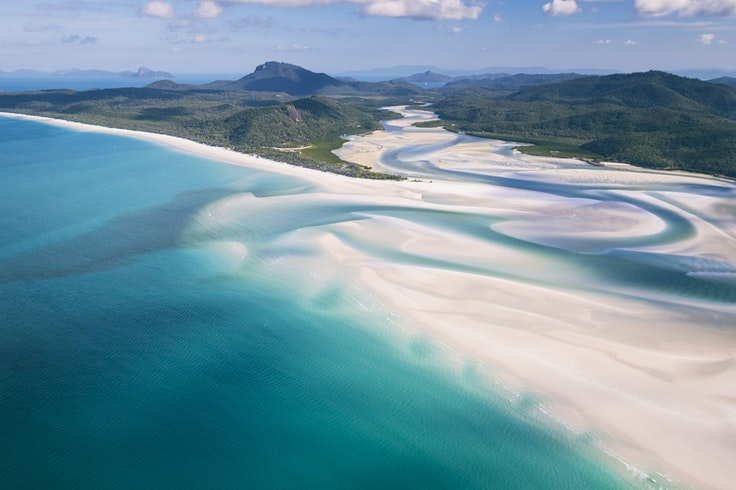 Beaches just don't come more photogenic than Australia's Whitehaven Beach, one gorgeous gateway to the Great Barrier Reef.