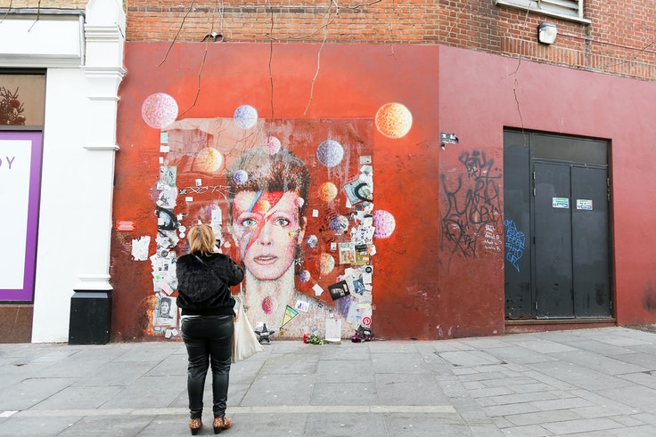 Artist James Cochran created the Ziggy Stardust mural near David Bowie's Brixton birthplace after the beloved artist's death.