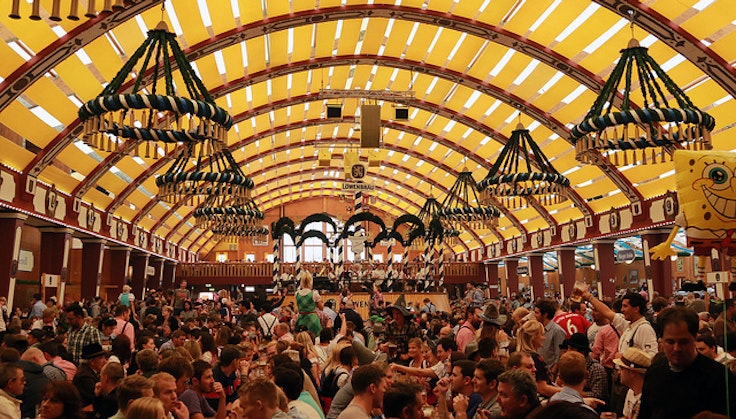 Oktoberfest revelers pack into a beer hall.