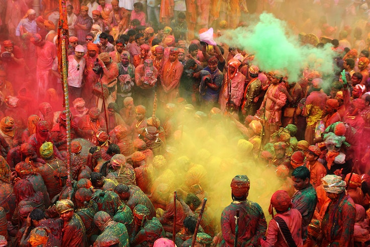The Hindu festival of Holi brings color and revelry to the Krishna temple in Nandgaon, India.