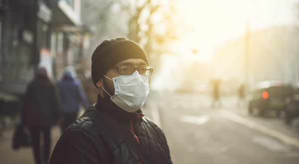 Can Wearing Masks Protect Travelers from Viruses?