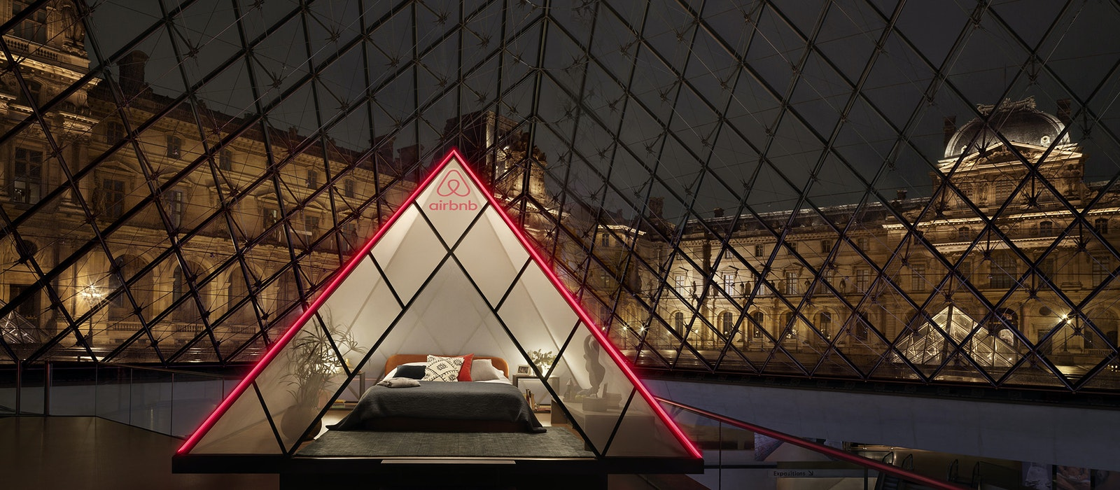 The bedroom for the night at the museum is set inside a mini version of the Louvre's famous glass pyramid.