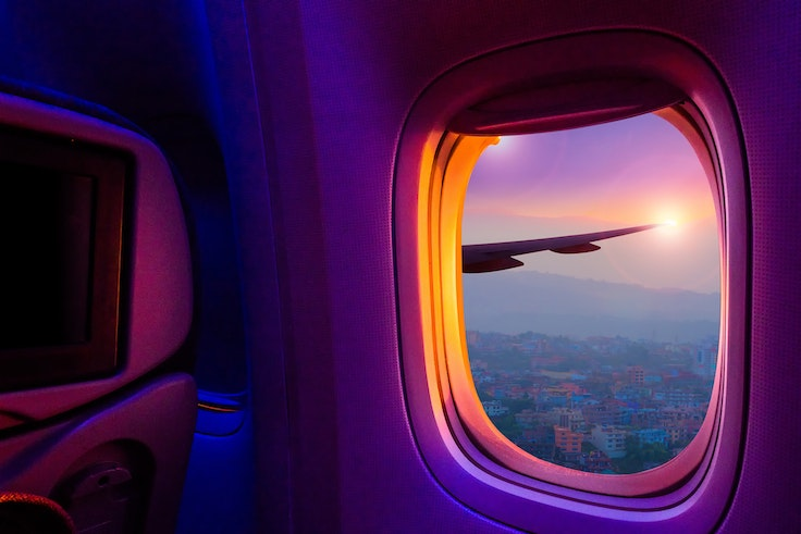 It can be difficult to fall asleep on an airplane—even if gazing out the window can lead to dreamy views.