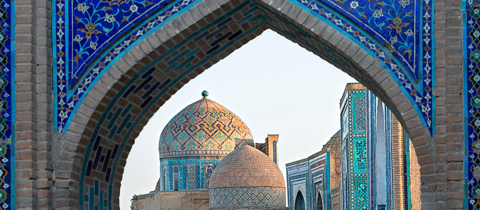 A view of ornate monumental tombs at the Shah-i Zinda Necropolis in Samarkand, Uzbekistan