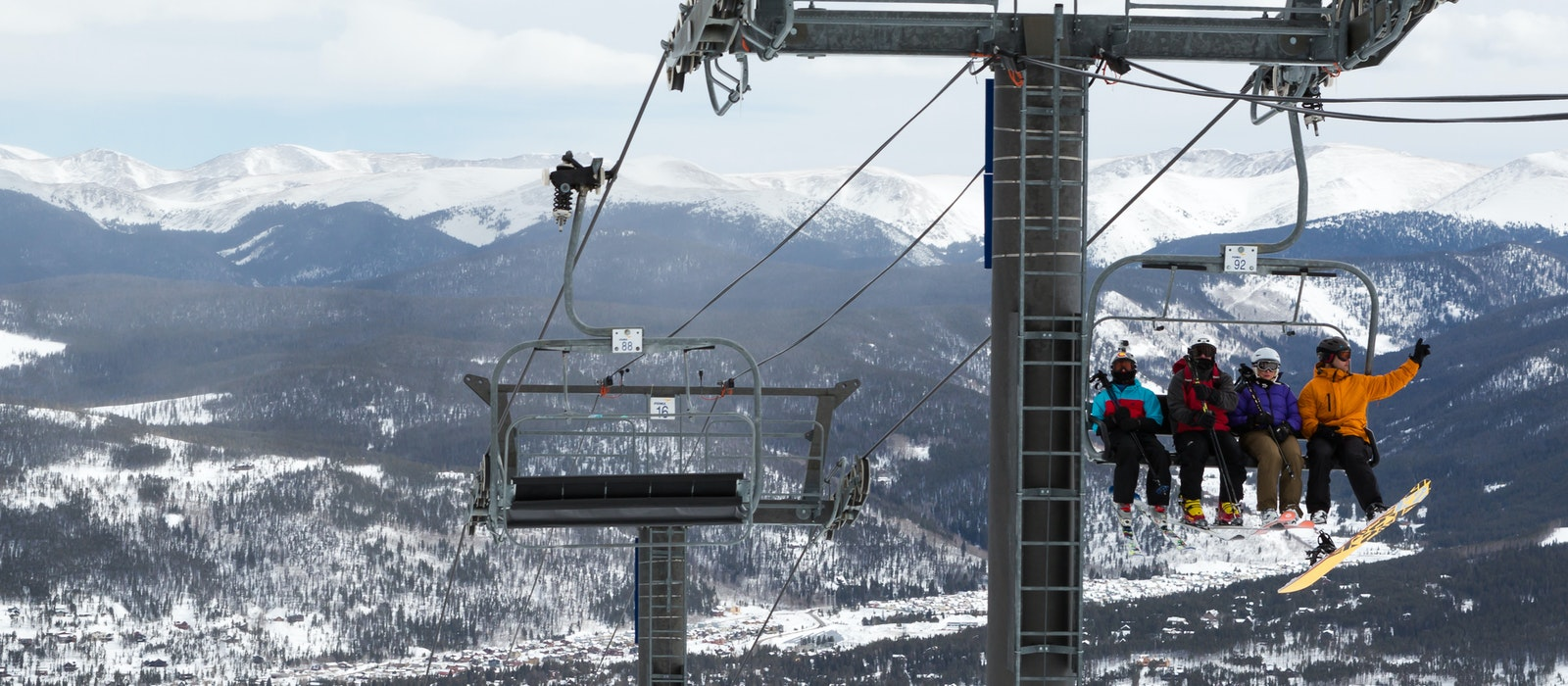 Skiiers and snowboarders ride a chairlift at Breckenridge Ski Resort in Colorado.